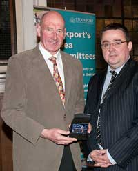 Brian (left) received the award   for his contribution to Sport.