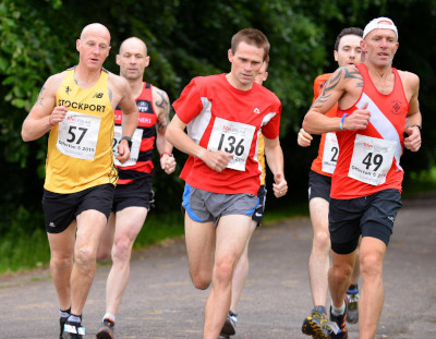 Andrew Lamont (136), powering past SHAC's Steve Crook and Salford's Mark Collier
